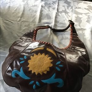 BCBGirls leather bag.  Lots of detail